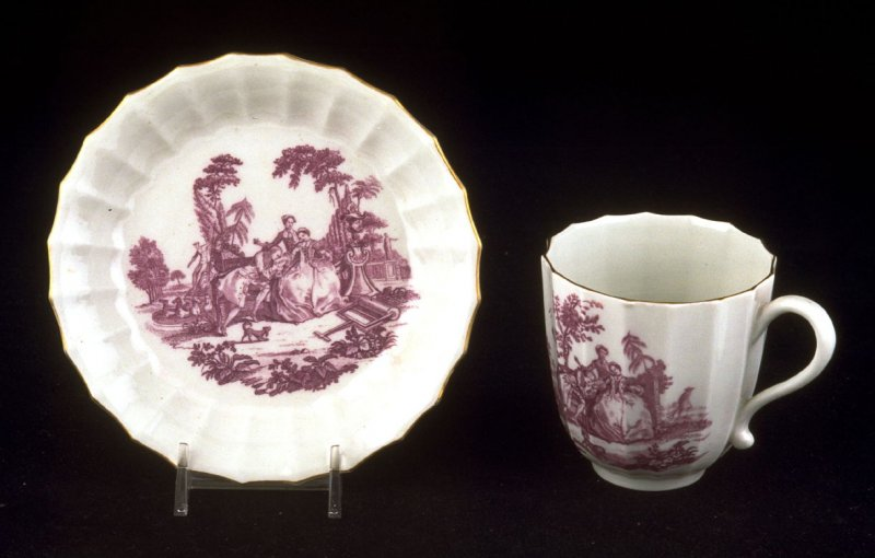 """Cup and saucer with """"The Teaparty"""""""